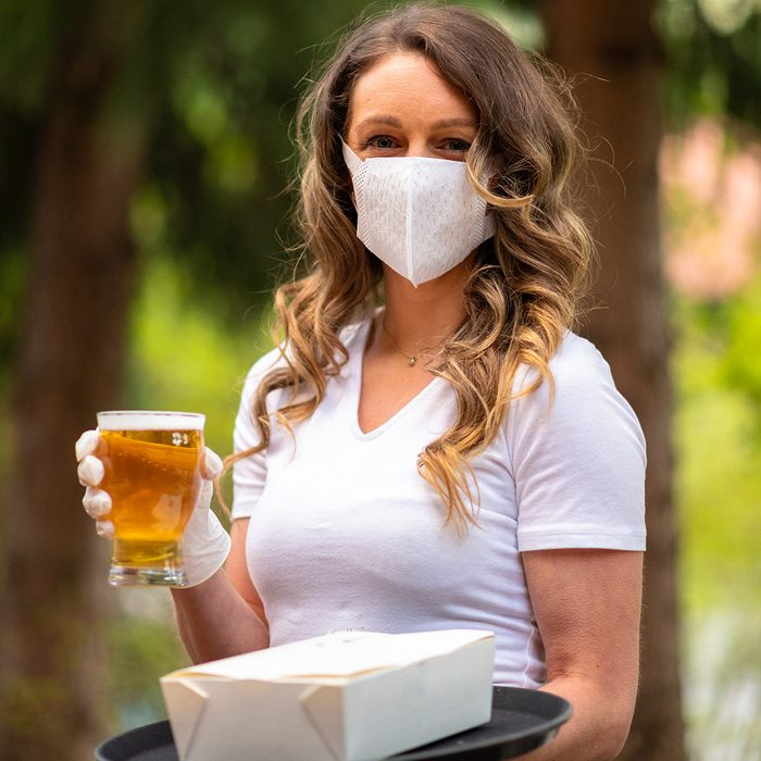 Server wearing a face mask to prevent the spread of COVID-19
