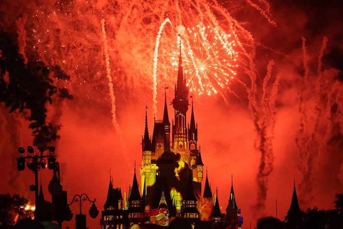 ORLANDO, FLORIDA, UNITED STATES - 2019/07/17: Red fireworks and yellow strobe lights illuminating the Cinderella Castle in the Walt Disney's Magic Kingdom themed park. The famous place is one of the most attended attractions in the world. (Photo by Roberto Machado Noa/LightRocket via Getty Images)