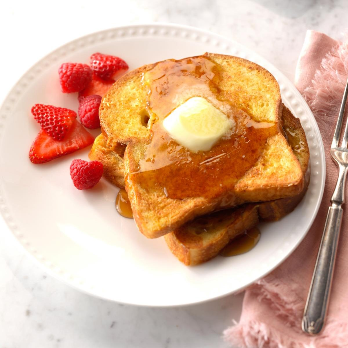 French toast with strawberries on side