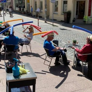 This German Cafe Is Using Pool Noodles to Help with Social Distancing