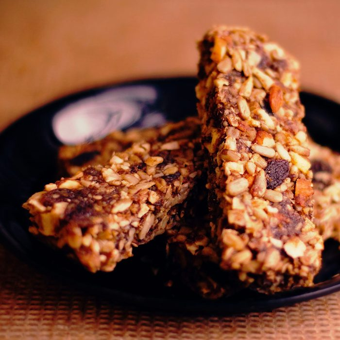 Several organic muesli bars centered on a plate.