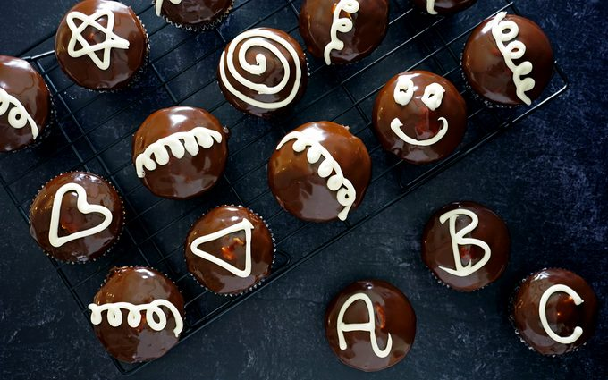 Decorating homemade hostess cupcakes with kids
