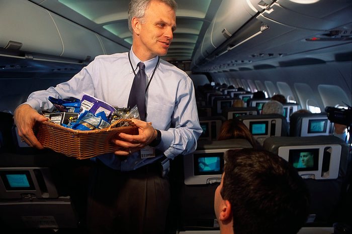 JetBlue Airways' CEO David Neeleman acts as a flight attendant during a flight from John F. Kennedy International Airport to Syracuse and back. (Photo by mark peterson/Corbis via Getty Images)