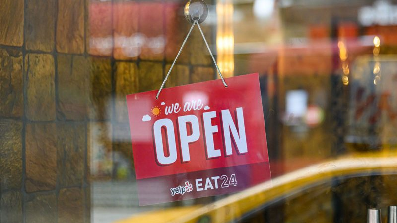 NEW YORK, NEW YORK - APRIL 27: A 'We Are Open' sign is seen outside a restaurant in Kips Bay during the coronavirus pandemic on April 27, 2020 in New York City. COVID-19 has spread to most countries around the world, claiming over 211,000 lives with over 3 million infections reported. (Photo by Noam Galai/Getty Images)