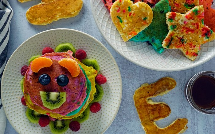 pancakes cut into fun shapes and dyed different colors appeal to kids