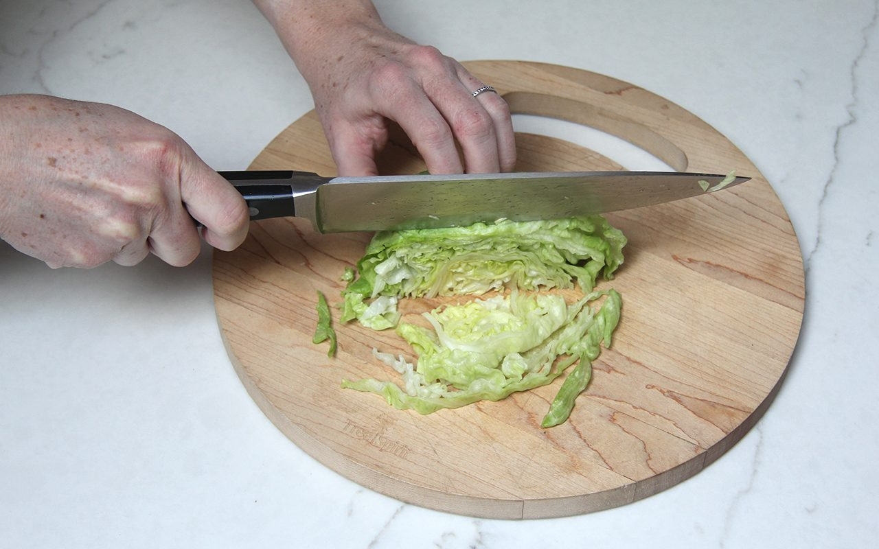 Slicing lettuce into shreds