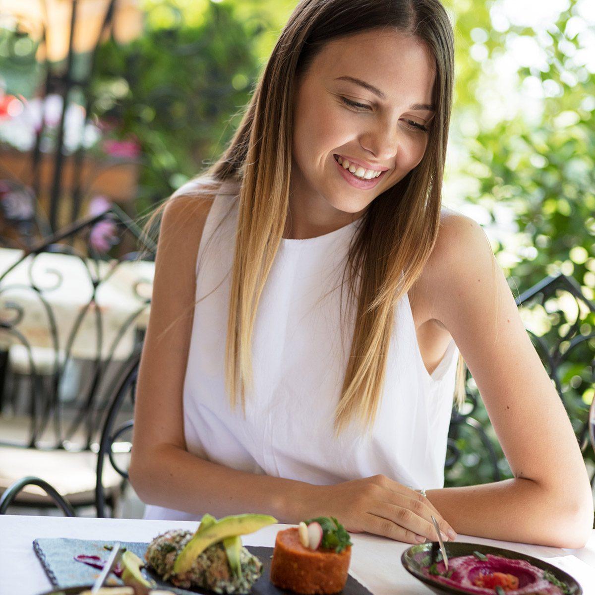 Woman in outdoor restaurant