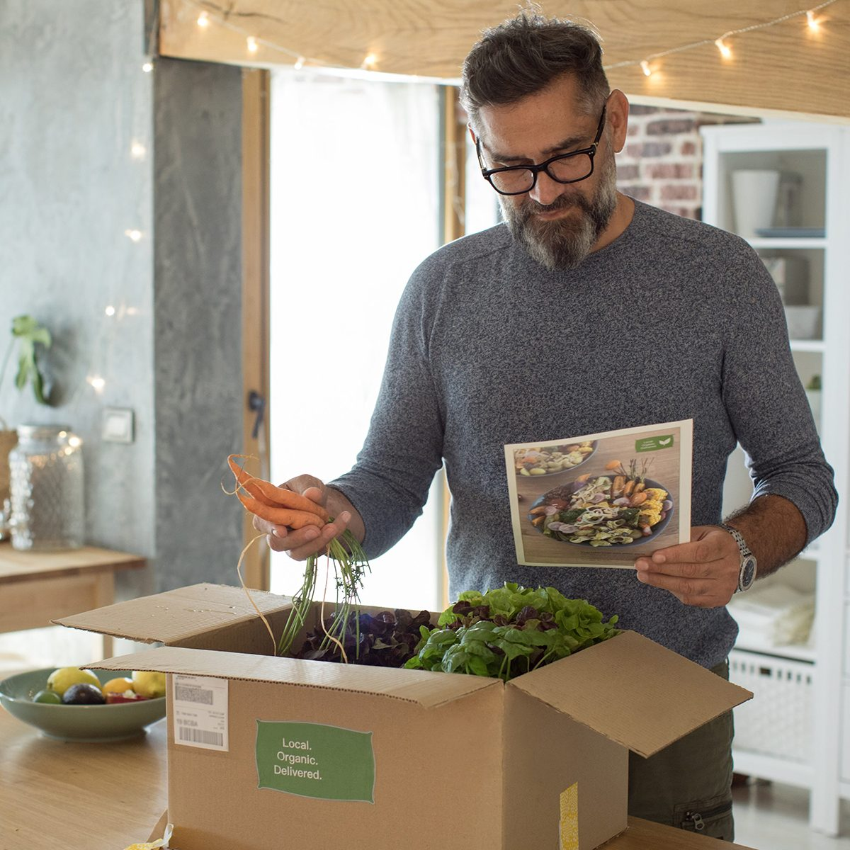 Man opening meal prep box