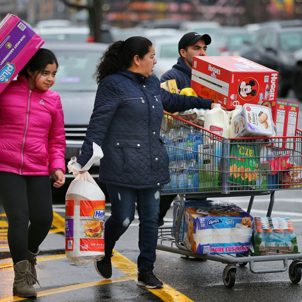 Family carrying items out of a Costco together