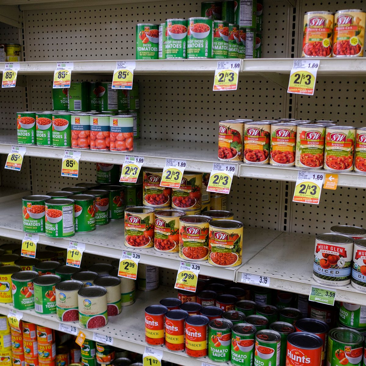 Shelf of canned food half empty