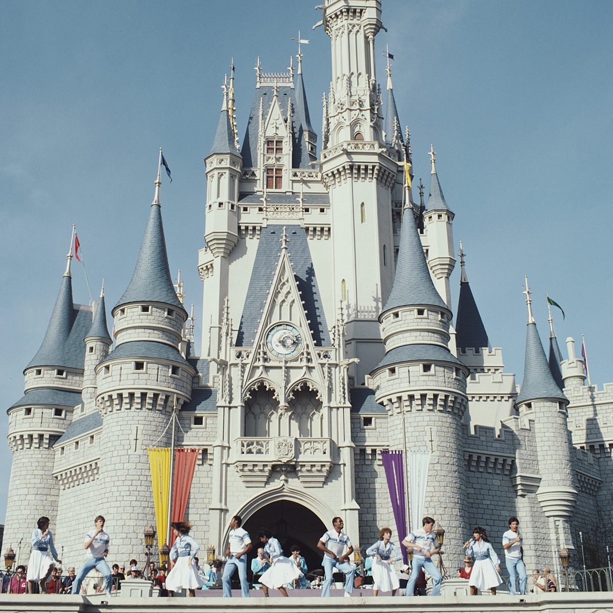 A show outside the Cinderella Castle at Walt Disney World, Florida, 1980. (Photo by Barbara Alper/Getty Images)