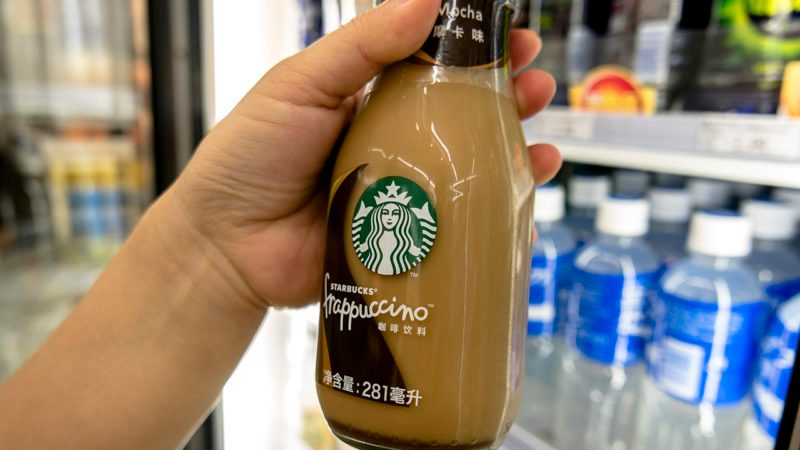 BEIJING, CHINA - 2017/06/09: Customer buys a Starbucks bottled Frappuccino in a Convenience Store. In the first quarter of 2017, targeting to the Chinese consumers, Starbucks introduced new tastes of bottled Frappuccino, which doubled the business of Starbucks instant drinks in China, and increased the market share by 5 percentage compared to the same period of last year. (Photo by Zhang Peng/LightRocket via Getty Images)