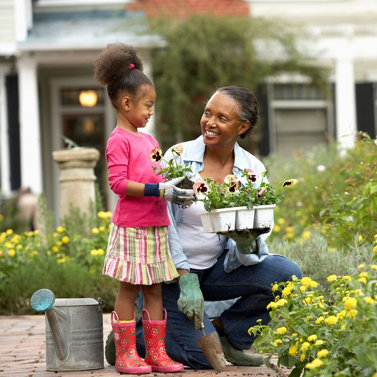 woman and girl gardening together