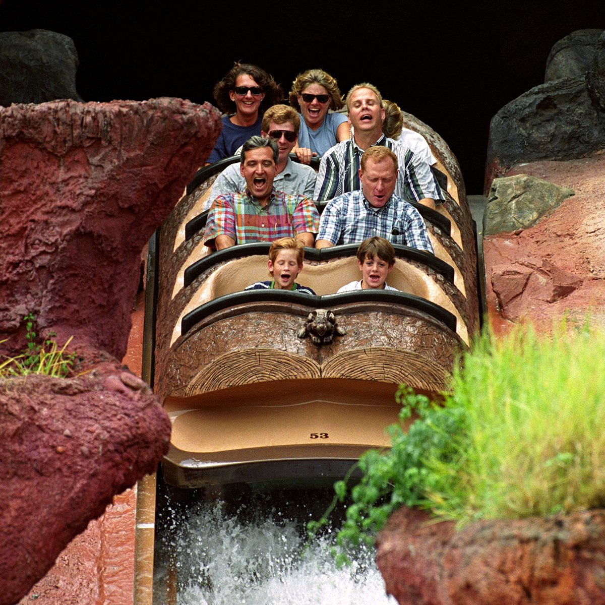 Prince Harry (front left) rides a Log Flume down Splash Mountain at Disney's Magic Kingdom in Florida, USA, leaning forward, hidden (top row right) is his mother the Princess of Wales. (Photo by Martin Keene - PA Images/PA Images via Getty Images)