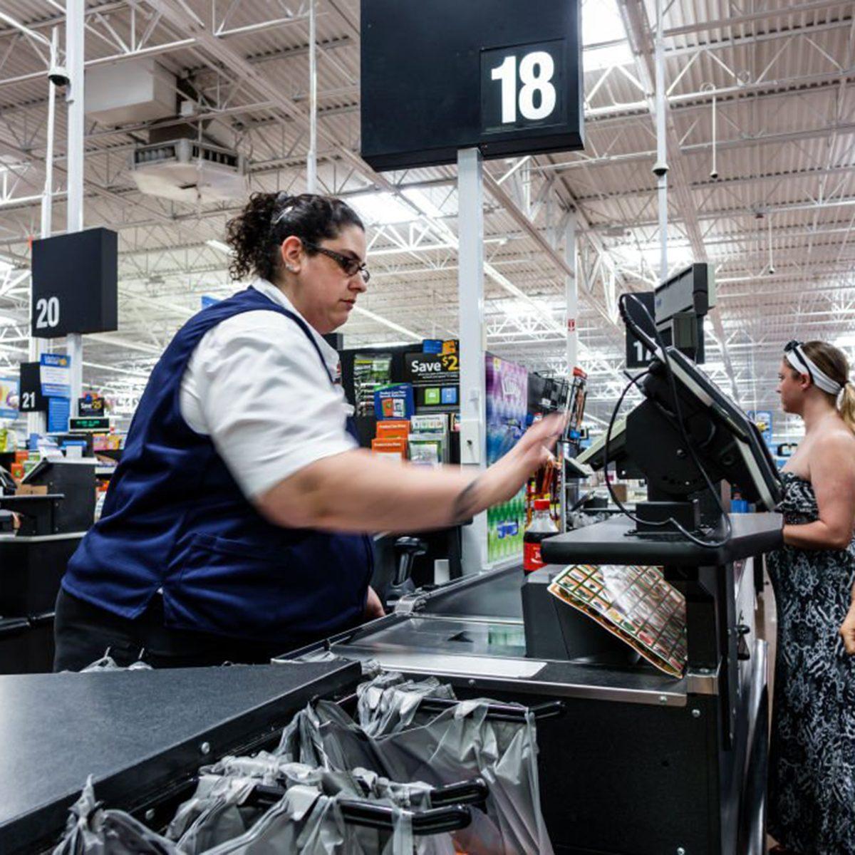 Walmart cashier checking someone out