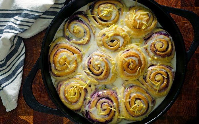 baked fresh blueberry sweet rolls by Joanna Gaines with lemon glaze on top