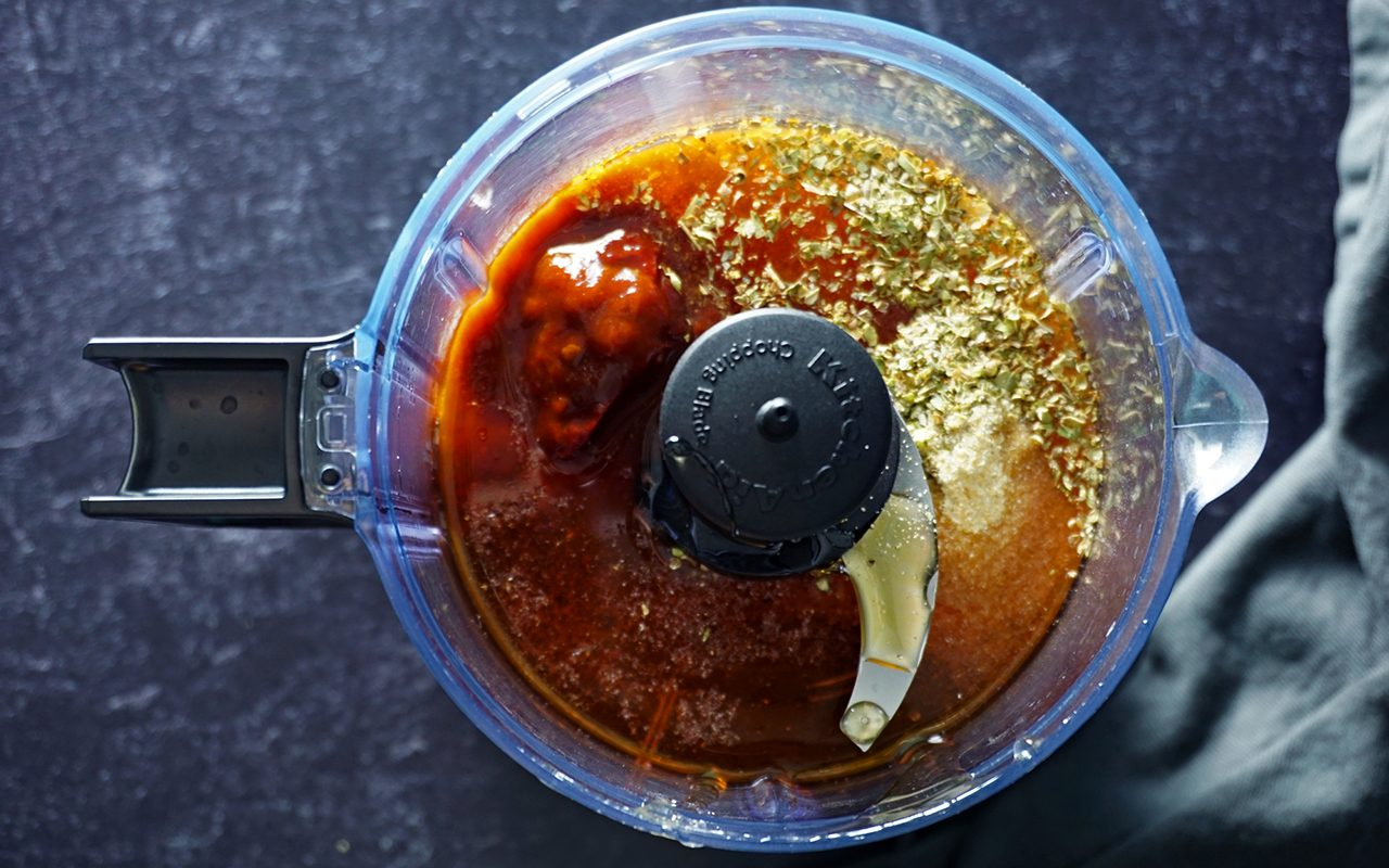 adding ingredients for copycat chipotle honey vinaigrette in a food processor