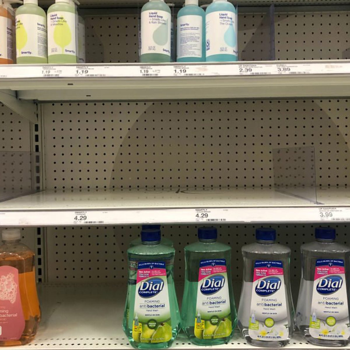 Sparse shelves of cleaning supplies