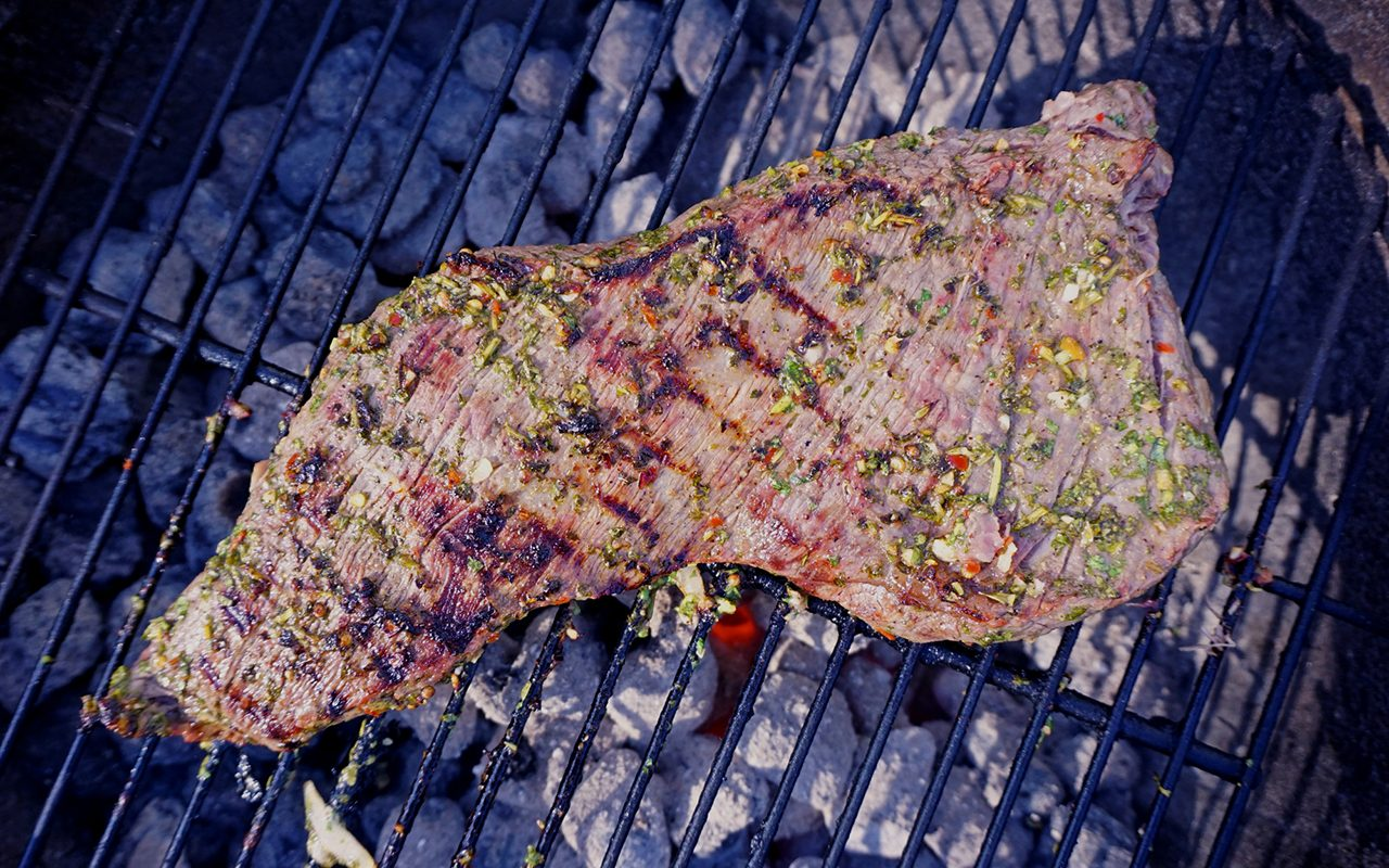 marinated tri-tip steak on the grill