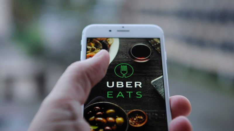 The Uber Eats app opening screen is seen on an iPhone on October 25, 2017. (Photo by Jaap Arriens/NurPhoto via Getty Images)
