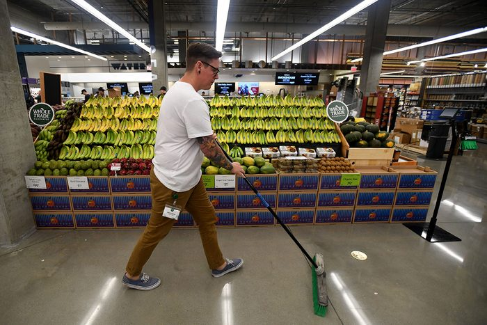 LONG BEACH, CA - OCTOBER 22: Kevin Kemp sweeps the produce section at the Whole Foods set to open October 23, at at the new 2nd and PCH shopping center in Long Beach on Tuesday, October 22, 2019. (Photo by Brittany Murray/MediaNews Group/Long Beach Press-Telegram via Getty Images)