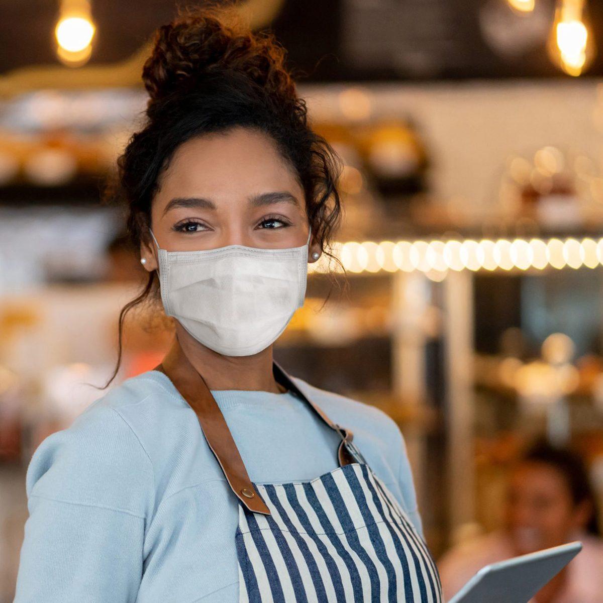 Masked waitress