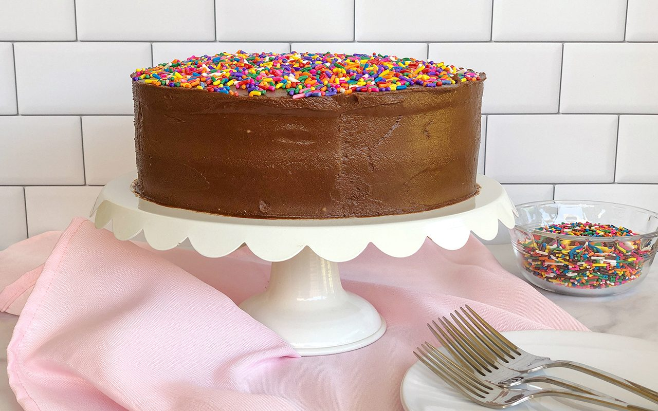Vegan birthday cake with chocolate frosting and sprinkles