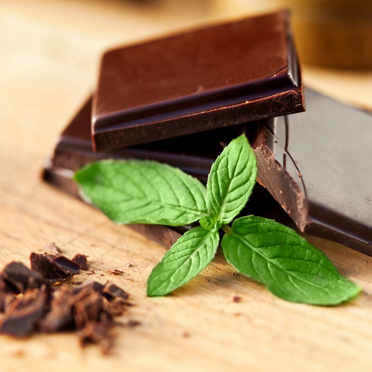 Chocolate and mint on a wooden table. Shallow depth of field.