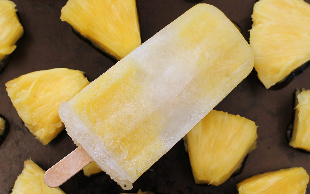 pineapple popsicle on pineapple pieces