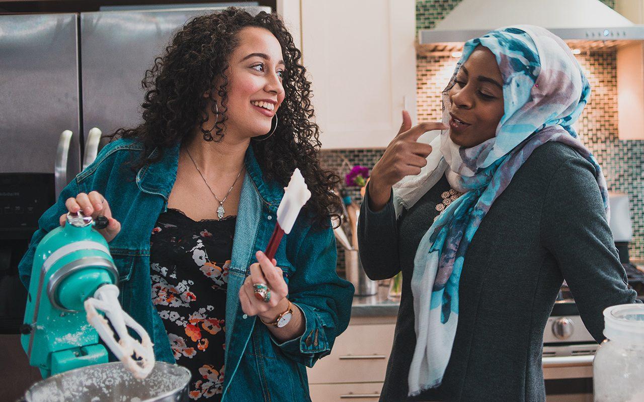 Two Muslim Women Tasting Cake Frosting