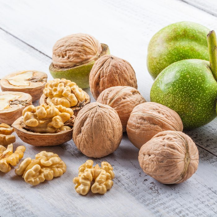 Walnuts on white wooden table