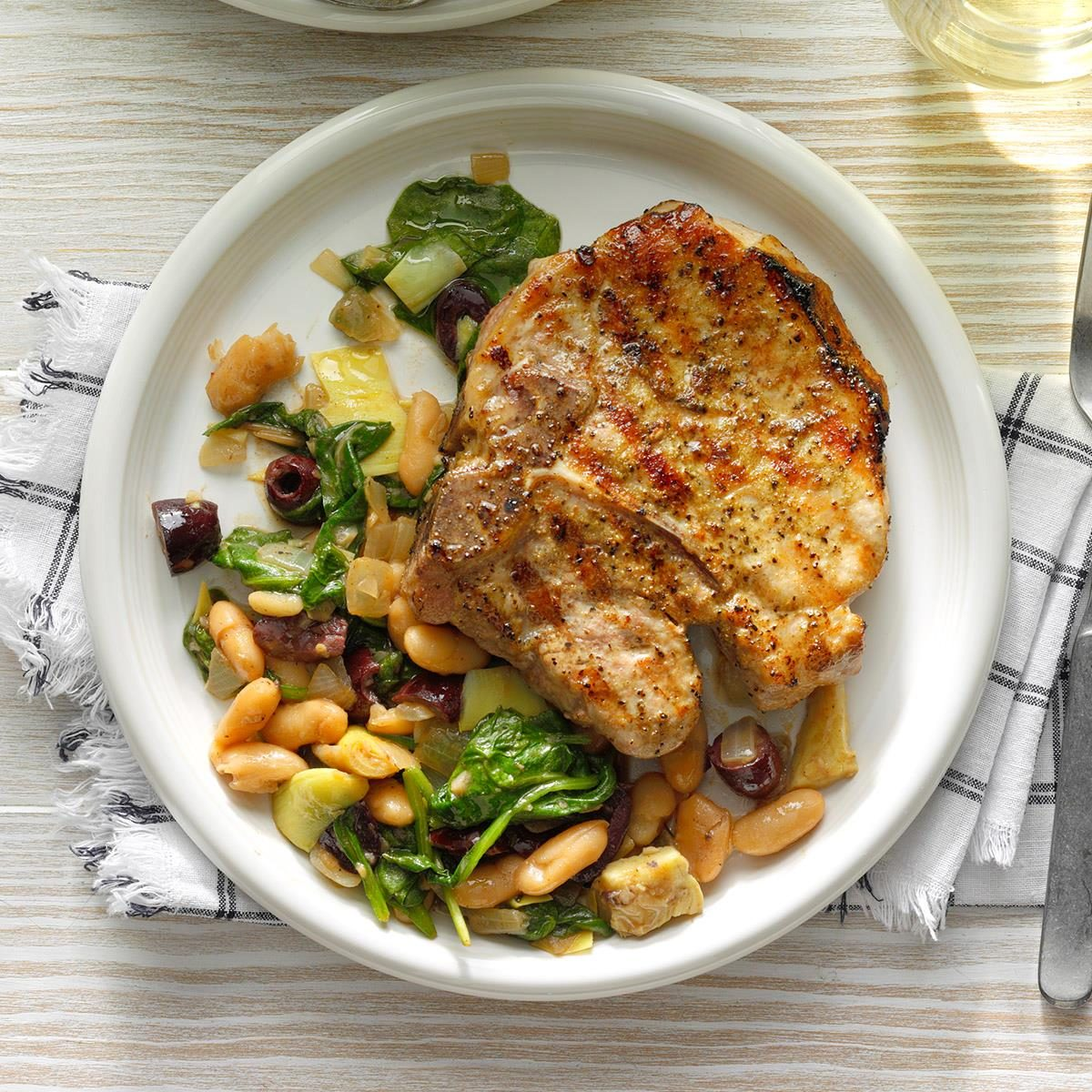 Runner-Up: Dry-Rub Grilled Pork Chops over Cannellini Greens