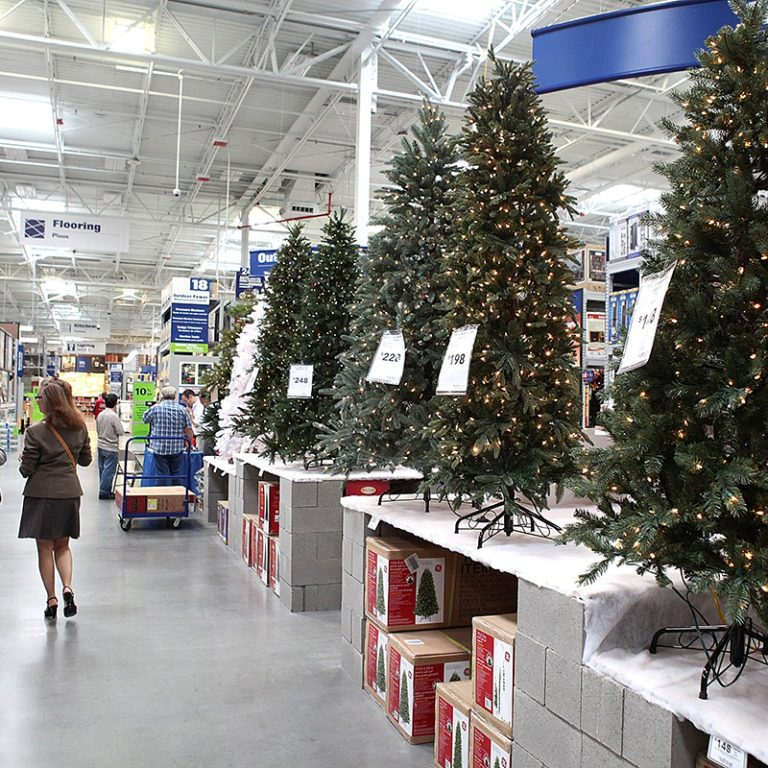 SAN FRANCISCO - NOVEMBER 04: Customers at a Lowe's home improvement store walk by a display of artificial Christmas trees on November 4, 2010 in San Francisco, California. With three weeks to go until Thanksgiving, retail stores are beginning to sell holiday merchandise. (Photo by Justin Sullivan/Getty Images)