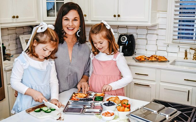 Holley Grainger cooking with daughters in her kitchen