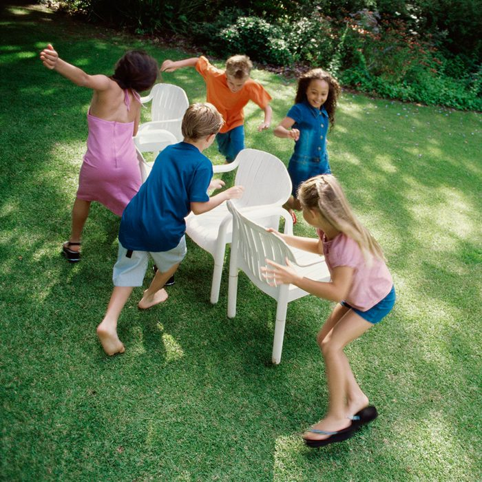 Children Playing Musical Chairs in Back Yard