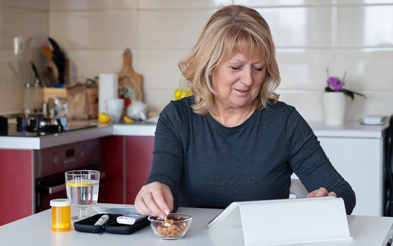Senior diabetic woman preparing a breakfast at home.