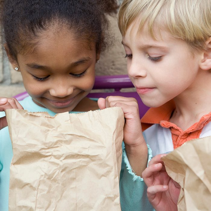 birthday party games for kids Boy Looking In Friends Lunch Bag At Recess