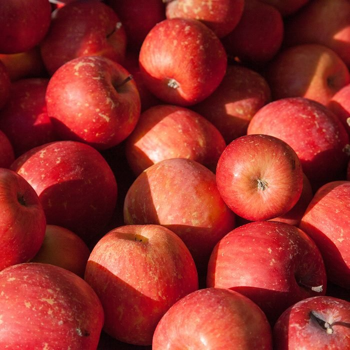 Close-up of stack of Fuji apples at a market