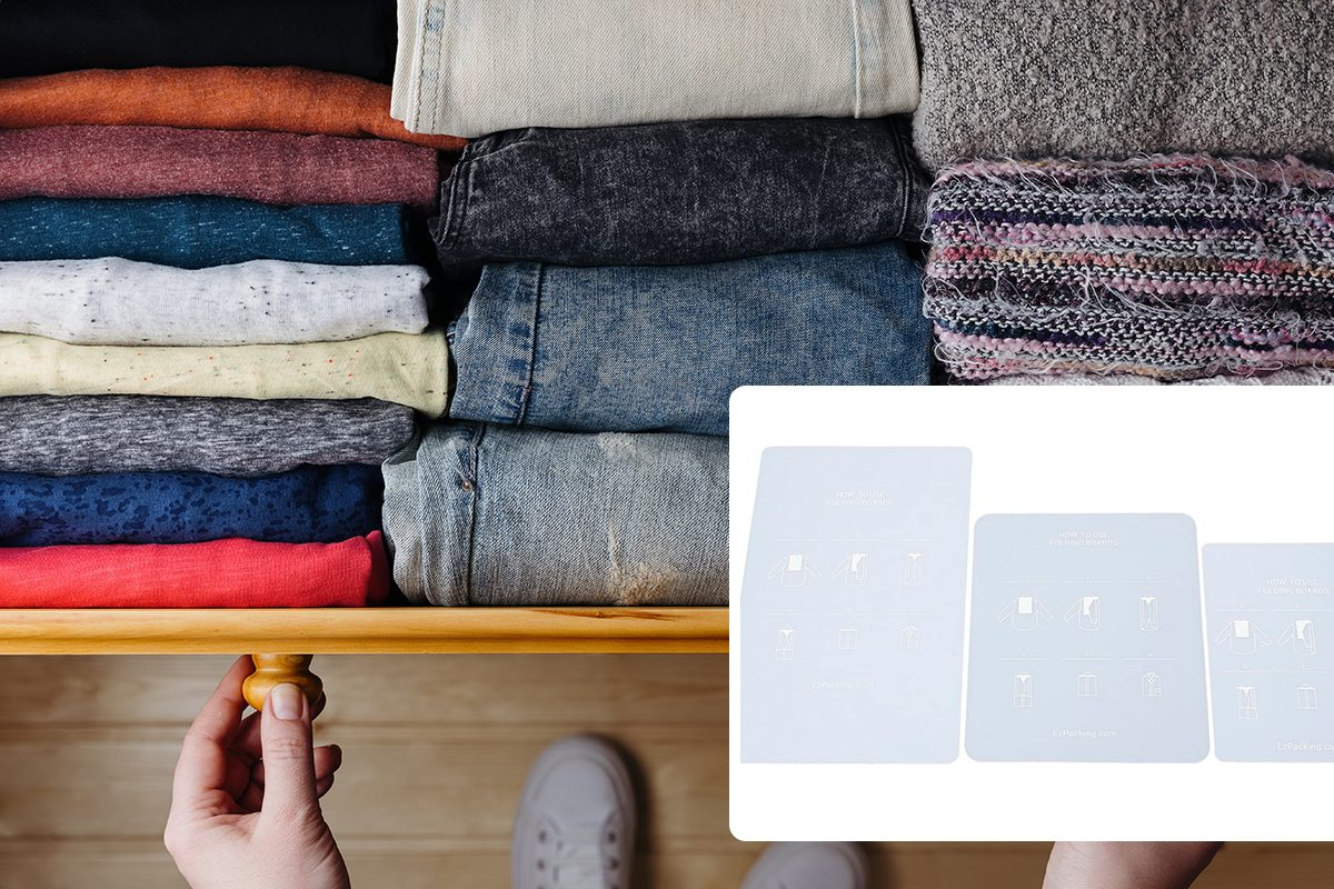 Overhead shot of neatly ordered clothes in wooden drawer. Woman organizing clothes in drawer/Overhead shot of neatly ordered clothes in wooden drawer. Woman organizing clothes in drawer