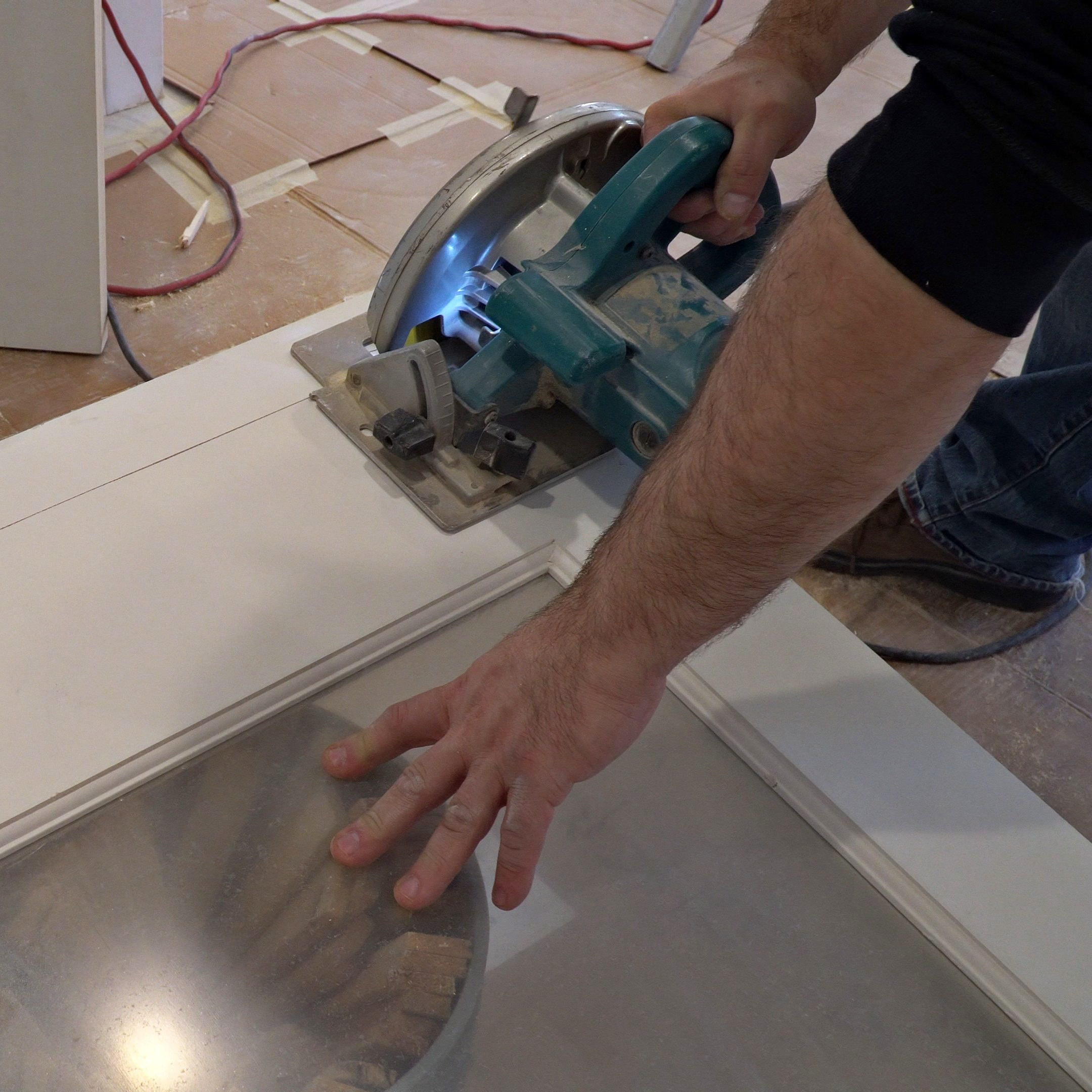 man using a circular saw for cutting wood door construction and home renovation, repair tools