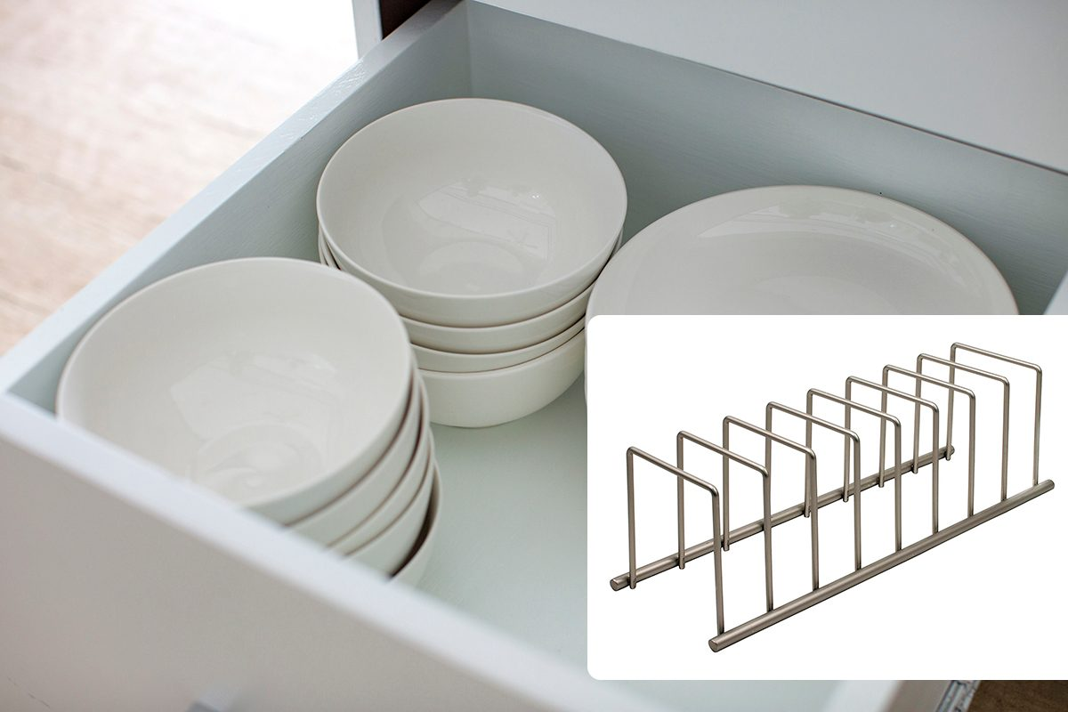 Opened drawer with white plates and bowls/Spectrum Diversified Euro Kitchen Organizer for Plates, Cutting Boards Bakeware, Cooling, Pots & Pans, Serving Trays, Reusable Containers, and Lids Holder Rack, Satin Nickel