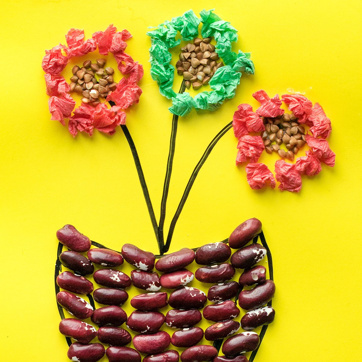 flower in pot from cereals, beans, dried leaves and colored paper Children's seasonal crafts from natural materials. Original children's art project. DIY creative handmade concept.