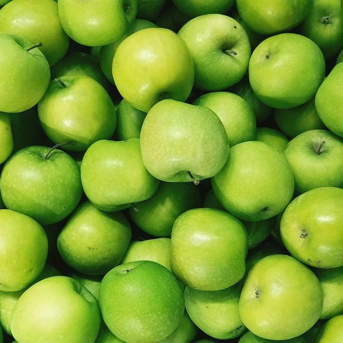 Full Frame Shot Of Granny Smith Apples For Sale In Market