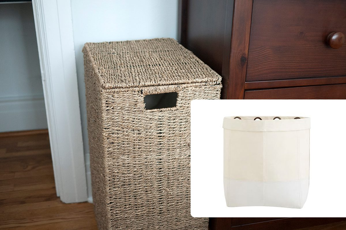 Light brown wicker laundry basket beside a wooden dresser in a bedroom./Gabrielle Organization System - Canvas Hanging Hamper