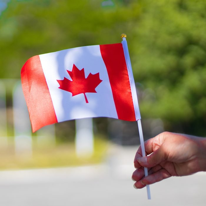 birthday party games for kids Female hand holding canadian flag to celebrate the canada day holiday