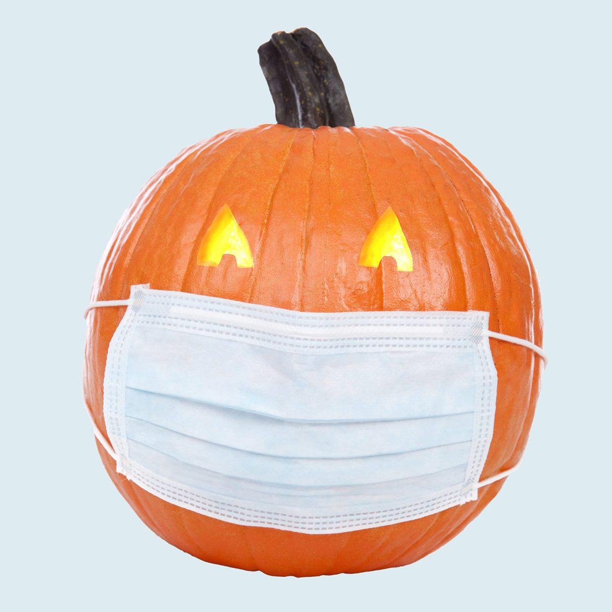 Jack-o-lantern wearing a face mask