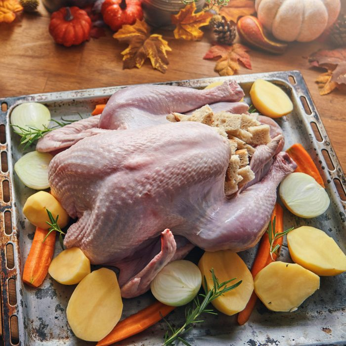 Preparing Stuffed Turkey with Vegetables and Other Ingredients for Holidays