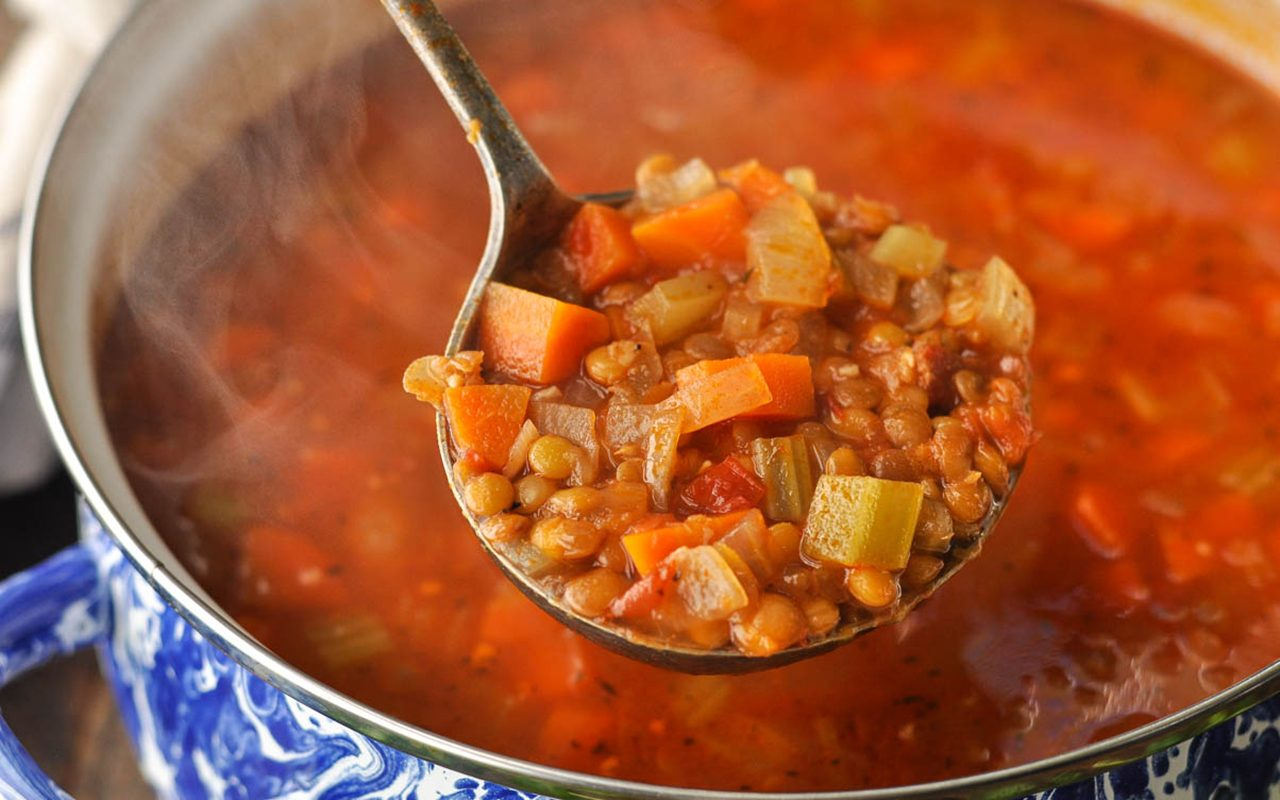 close up of spoon with lentil soup