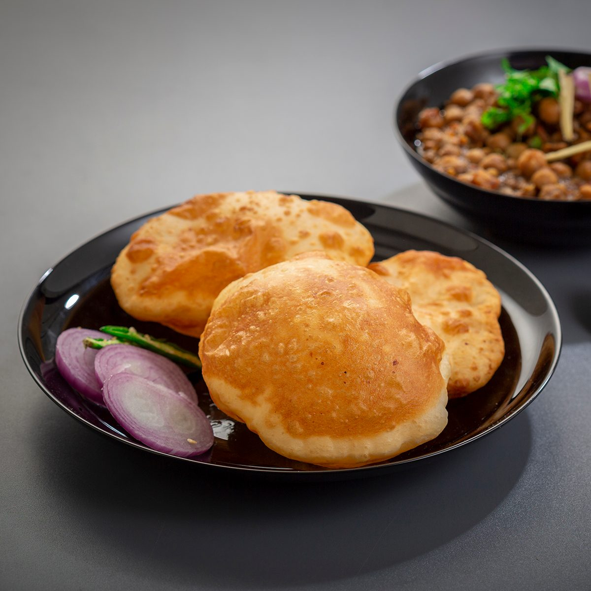 choley bhature is a dish originated initially in the northern part of the Indian subcontinent. It is a combination of chana masala and bhatura, a fried bread made from maida.