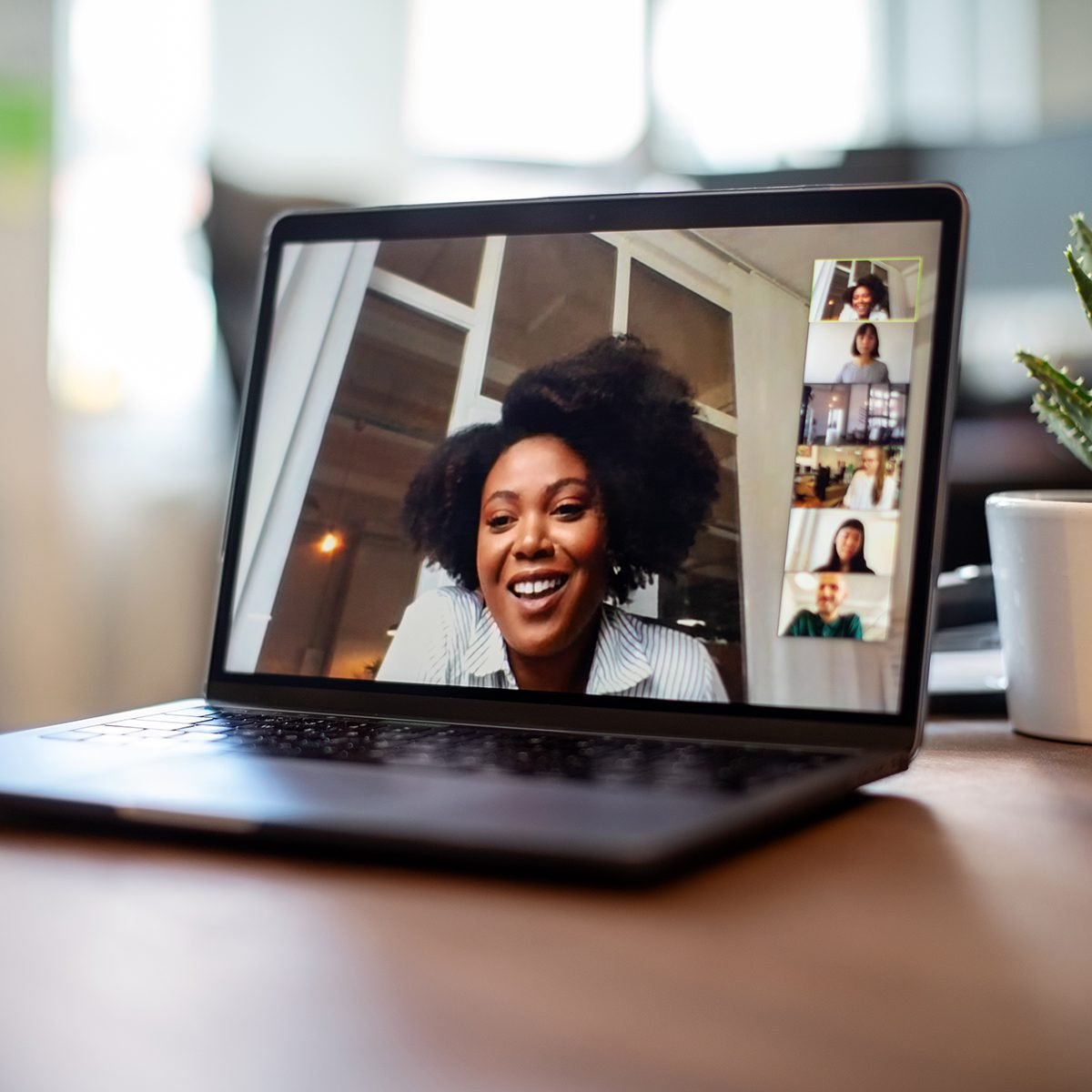 Shot of african businesswoman having a video call on a laptop with her team. Woman having meeting on video call on laptop with diverse colleagues,
